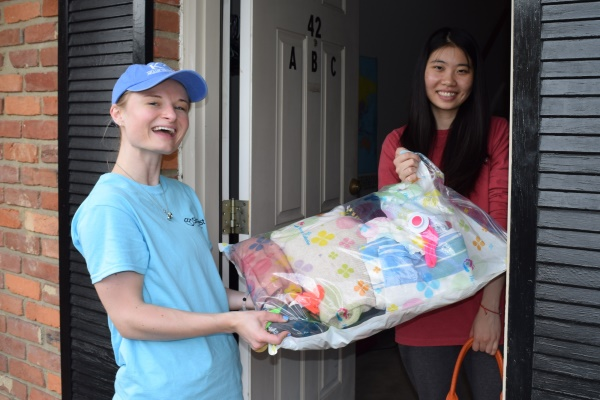 ShareFest volunteer picking up a donation from an off-campus residence